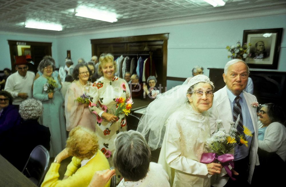 The mock wedding between Laura Dickie and Charles Kenyon as part of the festivities of their small rural community in Vermont, USA