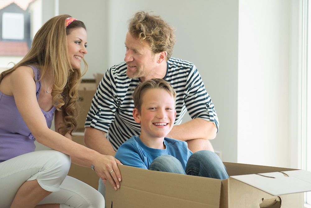Family removal new home smiling playing boxes