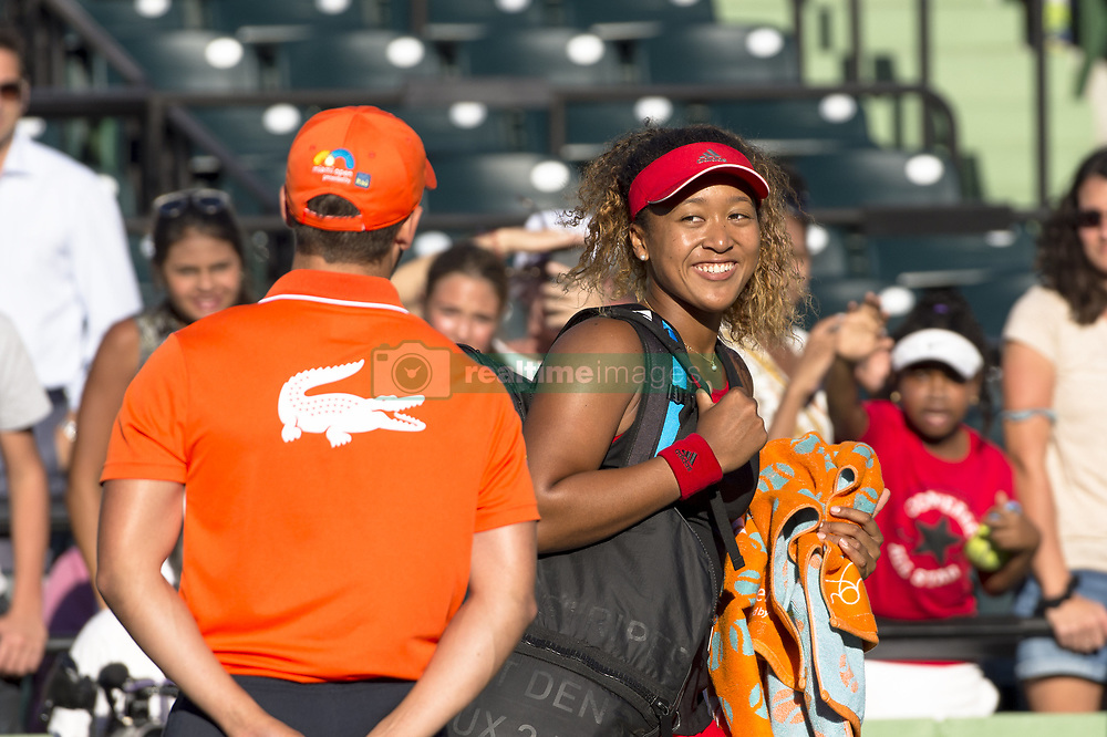 March 21, 2018 - Miami, FL, United States - Miami, FL - March, 21: Naomi Osaka (JPN) flashes a smile after defeating Serena Williams (USA) 63 62 at the 2017 Miami Open held at the Tennis Center at Crandon Park.   Credit: Andrew Patron/Zuma Wire (Credit Image: © Andrew Patron via ZUMA Wire)