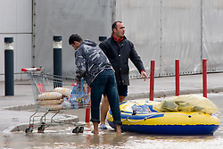People with food in shopping cart that was bought in Interspar who was surrounded by water on September 19, 2010, in Ljubljana, Slovenia. (Photo by Matic Klansek Velej / Sportida)