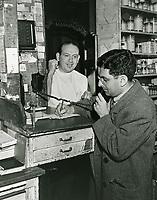 1945 Sidney Skolsky talks on the phone while Leon Schwab listens at Schwab's Drugstore
