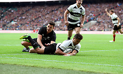 Barbarian's Richie Mo'unga scores his team's first try during the Autumn International match at Twickenham, London.