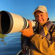 Dan shooting the Olympus 150-400mm zoom from a kayak. Minnesota