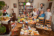 The Sturm Family of Hamburg, Germany. Astrid Hollmann, 38, and Michael Sturm, 38, and their three children Lenard, 12, Malte Erik, 10, and Lillith, 2.5, with their typical week's worth of food in June. <br /> ONE WEEK'S FOOD IN JUNE<br /> Food Expenditure for One Week: <br />  € 253.29 ($325.81 USD)<br /> Model Released.