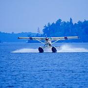 Seaplane landing on Moosehead Lake. Greenville , Maine