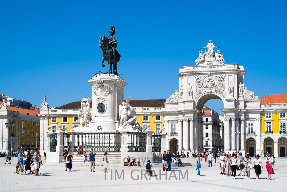 Tourists photographing bronze statue of Jose I on horseback - Portugal's king in Praca do Comercio -Terreiro do Paço, in Lisbon, Portugal