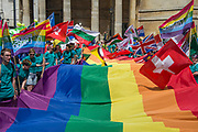 A huge rainbow flag represents all nations - The annual London Gay Pride march heads from Oxford Circus to Trafalgar Square.