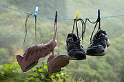 shoes hanging to dry with mountain in the background