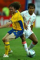 Faro 27/6/2004 Euro2004 <br />Svezia - Olanda 4-5 after penalties (0-0) <br />Mikael Nilsson of Sweden and Giovanni Van Bronckhorst of Netherlands<br />Photo Andrea Staccioli Graffiti