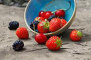 mixed fresh summer fruits - strawberry, blackberry, cherry