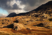 Afternoon sunlight on the boggy lower slopes of Glyder Fawr, looking across to Tryfan and Y Braich in the far distance.<br /> <br /> It was the first day I'd taken any of our kids up into the hills and the conditions were fantastic. Ed really loved being on the tops and it made Tryfan seem more spectacular than ever.