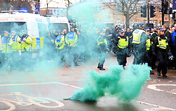 A smoke bomb is set off outside the stadium prior to the match