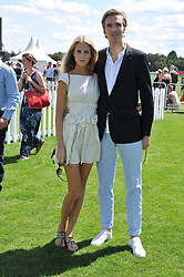 POPPY DELEVINGNE  and JAMES COOK at the 27th annual Cartier International Polo Day featuring the 100th Coronation Cup between England and Brazil held at Guards Polo Club, Windsor Great Park, Berkshire on 24th July 2011.