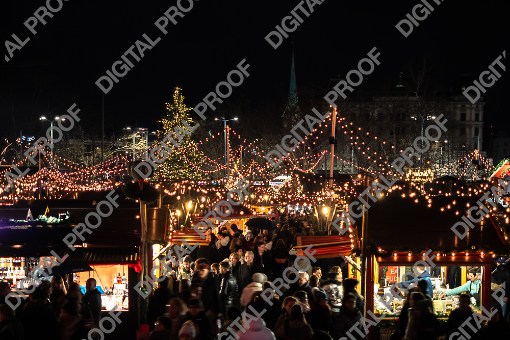 Zurich, Switzerland - December 22, 2018 Elevated view of stands and the visiting crowd of the Christmas market held at Sechseläutenplatz in front of the Opera house