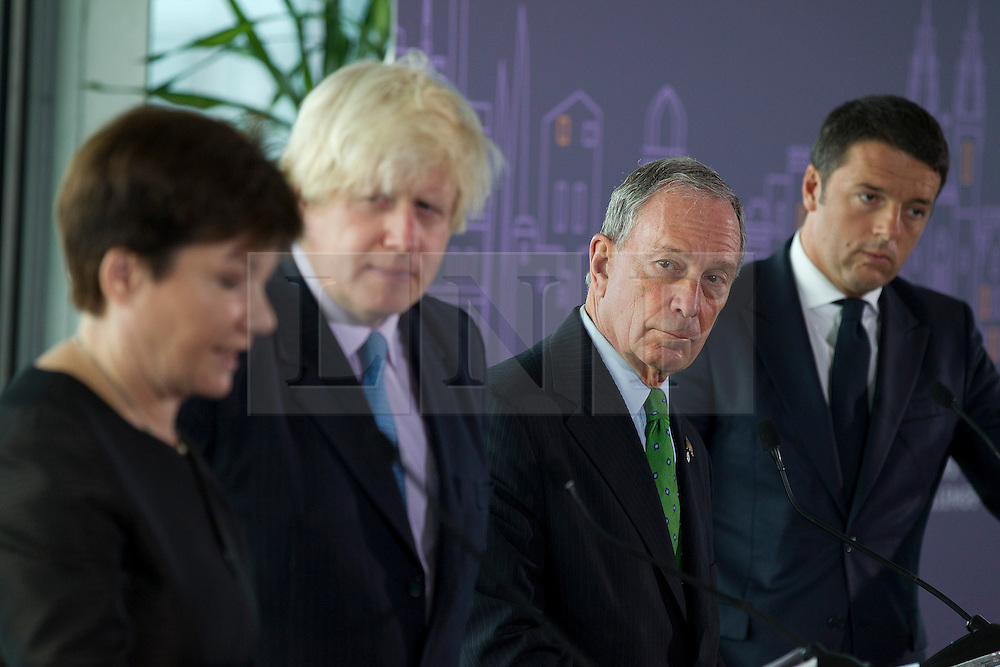 © Licensed to London News Pictures. 24/09/2013. London, UK. The Mayor of Warsaw, Hanna Gronkiewicz-Waltz (L), Boris Johnson, the Mayor of London (2L), Michael Bloomberg, the Mayor of New York (2R) and Matteo Renzi, the Mayor of Florence are seen at the launch of the 2013-2014 Mayor's Challenge at City Hall in London today (24/09/2013). The competition, sponsored by Bloomberg Philanthropies, aims to aid cities to come up with bold solutions to urban challenges  Photo credit: Matt Cetti-Roberts/LNP