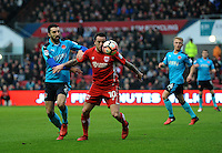 Fleetwood Town's Conor McLaughlin battles with Bristol City's Lee Tomlin<br /> <br /> Photographer Ashley Crowden/CameraSport<br /> <br /> Emirates FA Cup Third Round - Bristol City v Fleetwood Town - Saturday 7th January 2017 - Ashton Gate - Bristol<br />  <br /> World Copyright © 2017 CameraSport. All rights reserved. 43 Linden Ave. Countesthorpe. Leicester. England. LE8 5PG - Tel: +44 (0) 116 277 4147 - admin@camerasport.com - www.camerasport.com