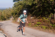 Cragsmoor, New York - A runners\ in the 30-mile race follows the trail near Sam's Point during the Shawangunk Ridge Trail Run/Hike on Sept. 16, 2017.