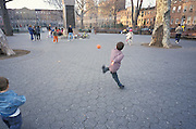 Boy off balance kicking a ball