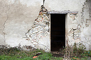 dilapidated wall with door opening