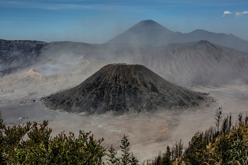 View of Mt. Bromo crater (far left),  Mount Batok in the foreground and Mt. Semeru in the background. from the Mt. Penanjakan lookout at Bromo Tengger Semeru National Park, East Java, Indonesia.