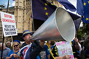 Anti Brexit protester Steve Bray using his loud hailer in Westminster on the day after Parliament voted to take control of Parliamentary proceedings and prior to a vote on a bill to prevent the UK leaving the EU without a deal at the end of October, on 4th September 2019 in London, England, United Kingdom. Yesterday Prime Minister Boris Johnson faced a showdown after he threatened rebel Conservative MPs who vote against him with deselection, and vowed to aim for a snap general election if MPs succeed in a bid to take control of parliamentary proceedings to allow them to discuss legislation to block a no-deal Brexit.
