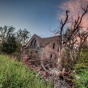 Vacant farmhouse just outside of Stafford, Kansas.