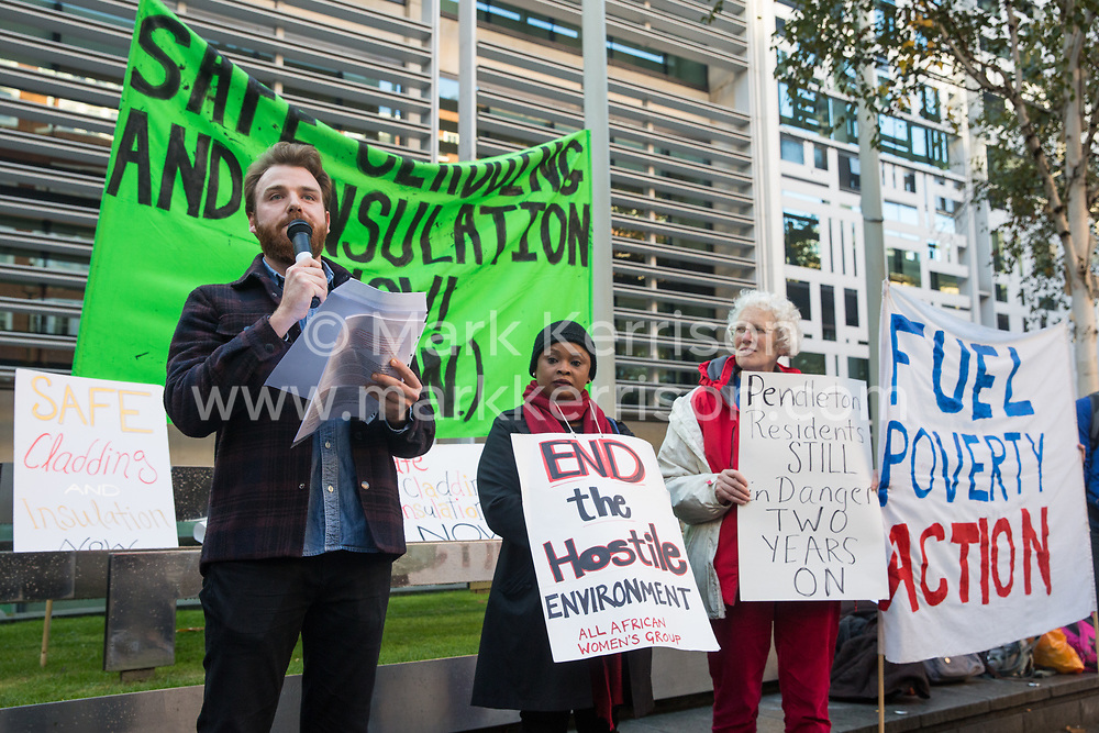 London, UK. 17 October, 2019. A speaker from Fuel Poverty Action (FPA) addresses fellow campaigners, residents in uninsulated homes and climate activists protesting outside the Ministry of Housing, Communities and Local Government (MHCLG) before delivering a letter signed by FPA, 80 organisations, trade unions and MPs in just ten days precisely one year after a strongly worded letter about the urgency of recladding flammable buildings and insulating those that are cold was delivered to the Government department. Commitments made by the MHCLG in response to the original letter have not been met. Credit: Mark Kerrison/Alamy Live News