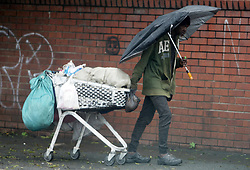 South Africa - Durban - 04 October 2020 -  A homeless man pulls his trolley in the streets of Durban while holding an umbrella in the rain.<br /> Picture: Bongani Mbatha/African News Agency(ANA)