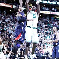 10 May 2012: Boston Celtics power forward Kevin Garnett (5) takes a jumpshot over Atlanta Hawks power forward Josh Smith (5) during the Boston Celtics 83-80 victory over the Atlanta Hawks, in Game 6 of the Eastern Conference first-round playoff series, at the TD Banknorth Garden, Boston, Massachusetts, USA.