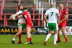 11th November 2018 , Racecourse Ground,  Wrexham, Wales ;  Rugby League World Cup Qualifier,Wales v Ireland ; Tyrone McCarthy of Ireland is tackled by Curtis Davies of Wales <br /> <br /> <br /> Credit:   Craig Thomas/Replay Images