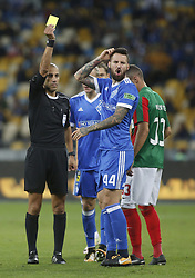 August 24, 2017 - Referee from Israel Liran Liany  makes a yellow card   Tamás Kádár  of Dynamo  during the  Europa League second play-off soccer match between FC Dynamo Kyiv and FC Maritimo, at the Olimpiyskyi stadium in Kyiv, Ukraine, August 24, 2017. (Credit Image: © Anatolii Stepanov via ZUMA Wire)