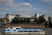 River cruise boat passes The Royal Festival Hall, part of London's Southbank arts area. The Royal Festival Hall is a 2,900 seat concert venue within Southbank Centre in London. It is situated on the South Bank of the River Thames, not far from Hungerford / Golden Jubilee Bridge. Opened in 1951, it is a Grade I listed building.