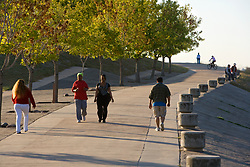 Walking and biking on a path at Storey Park in Houston, Texas