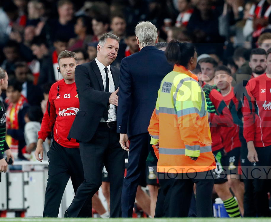 Doncaster's Darren Ferguson shakes hands with Arsenal's Arsene Wenger during the Carabao Cup Third Round match at the Emirates Stadium, London. Picture date 20th September 2017. Picture credit should read: David Klein/Sportimage
