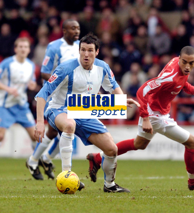 Photo: Leigh Quinnell.<br /> Nottingham Forest v Swindon Town. Coca Cola League 1. 25/02/2006. Swindons Lee Peacock makes off with the ball.