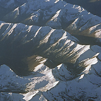 Aerial view of snowcapped mountain peaks.
