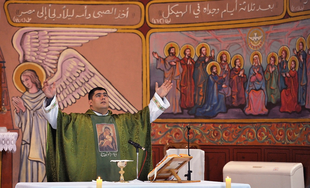 Father Jorge Hernandez celebrates Mass in the Holy Family Catholic Parish in Gaza City. There are only some 3,000 Christians in Gaza, of which just 200 are Catholic. Father Hernandez is Argentinian, and a missionary of the Argentina-based Institute of the Incarnate Word..