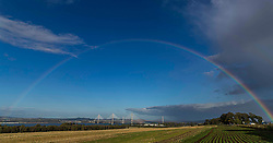 A rainbow arches over the Forth Bridges near Edinburgh. The nearest bridge if the Queensferry Crossing with the Forth Road Bridge in the middle and the iconic Forth Rail Bridge at the rear.