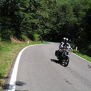 Tratto di strada nei boschi nelle vicinanze di Colle Brianza..Bikers on road through the woods near Colle in Brianza