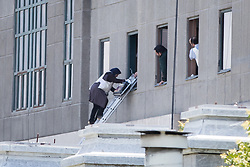 Jun 7, 2017 - Tehran, Iran - A woman is being evacuated from the parliament building after gunmen opened fire at Iran's parliament and the shrine of Ayatollah Khomeini in the capital Tehran, Iran. The terrorist militia ISIS claimed responsibility for the attacks. (Credit Image: © Erfan Kouchari/Tasnim/IranImages via ZUMA Wire)