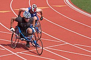 West Point, New York - Air Force athletes Mark Johnson, left, and Andrew Evans push through the turn in the wheelchair 200-meters in the 2014 Army Warrior Trials at the United States Military Academy Preparatory School on Tuesday, June 17, 2014.<br /> Hosted by the U.S. Army Warrior Transition Command (WTC), the trials determine which athletes will compete at the 2014 Warrior Games this fall in Colorado Springs, Colorado.