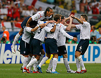 Photo: Glyn Thomas.<br />England v Ecuador. 2nd Round, FIFA World Cup 2006. 25/06/2006.<br /> England's David Beckham is mobbed by teammates after giving his side a 1-0 lead.