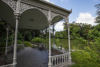 Gazebo at Swan Lake, Singapore Botanic Garden - Made of cast iron with detailed etchings on her beams, stands proudly at the edge of the lake.<br /> This Gazebo was first located on Grange Road in the 1850s. The Singapore Botanic Garden is a major visitor attraction in Singapore displaying a huge array of botanical & horticultural life with a world class plant collection.  Enhancing these resources are recreational facilities, educational displays and events for visitors. The garden was first set up by Stamford Raffles, who was the founder of Singapore as well as being a naturalist at Fort Canning.  In 2015 the Gardens was named a UNESCO World Heritage Site.