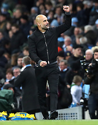 Manchester City manager Pep Guardiola celebrates after the final whistle during the Premier League match at the Etihad Stadium, Manchester.