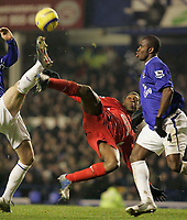 Photo: Dave Howarth.<br /> Everton v Liverpool. The Barclays Premiership. 28/12/2005. Liverpool's Djibril Cisse tries the overhead kick past Everton's Joseph Yobo