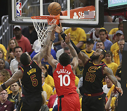 May 7, 2018 - Cleveland, OH, USA - Cleveland Cavaliers' J.R. Smith (left) and LeBron James (right) defend a second quarter shot inside by Toronto Raptors' DeMar DeRozan in Game 4 of a second-round playoff series on Monday, May 7, 2018 in Cleveland, Ohio. (Credit Image: © Phil Masturzo/TNS via ZUMA Wire)