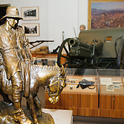 """Statue of Simpson and his Donkey at the Australian War Memorial in Canberra, ACT, Australia. John (Jack) Simpson Kirkpatrick (6 July 1892–19 May 1915 aged 23) was a stretcher bearer with the Australian and New Zealand Army Corps during the Gallipoli Campaign, in World War I. After landing at Anzac Cove on 25 April 1915, he obtained a donkey and began carrying wounded British Empire soldiers from the frontline to the beach, for evacuation. He continued this work for three and a half weeks, often under fire, until he was killed. Simpson and his Donkey are a key part of the """"Anzac legend"""". He joined the army so that he might be sent back to England to fight for his own country."""