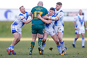 Hunslet Club Parkside interchange Adam Biscomb (17) is stopped by three Workington Town  players during the Ladbrokes Challenge Cup round 3 match between Hunslet Club Parkside and Workington Town at South Leeds Stadium, Leeds, United Kingdom on 24 February 2018. Picture by Simon Davies.