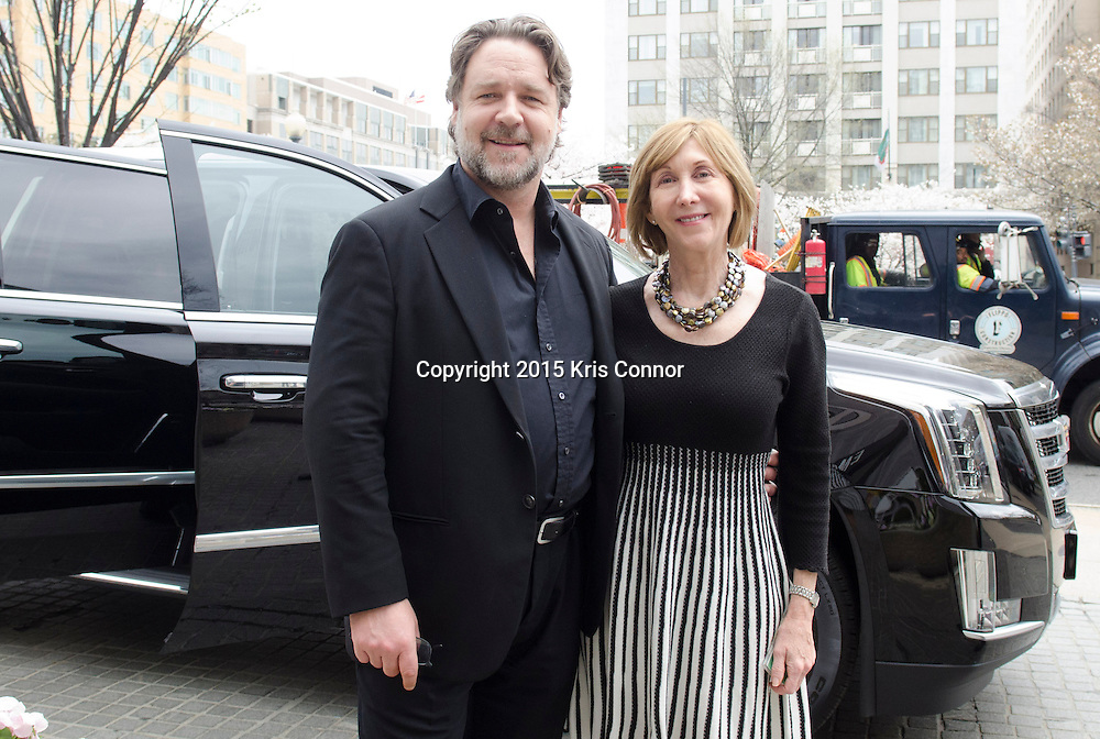 """Russell Crowe and Teresa Keleher, Australia Embassy Cultural Attache after viewing the """"A Centenary of Australian War Art"""" exhibit at the Embassy of Australia in Washington DC on April 7th, 2015. Crowe and Rodgers are visiting the nation's capitol to promote the new Warner Bros. Pictures' movie """"The Water Diviner,"""" which will be release on April 24th. Photo by Kris Connor for Warner Bros. Pictures"""