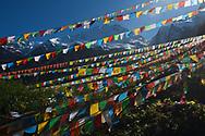 Buddhist Prayer flags, the pilgrimage route around Meili Snow Mountain/Kawagebo/Kawagarbo, 6740 m, a Sacred mountain for Tibetan Buddhists, yet unclimbed, at the waterfall near Yubeng, Yunnan, China